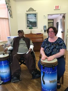 Katrina Valliant drumming with Mr. Buckner